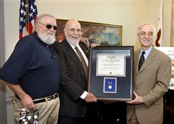 Deputy Secretary of Defense Gordon England (right) presents the Department of Defense Medal for Distinguished Public Service to Robert Rosenthal. photo by R. D. Ward